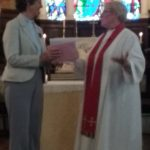 Revd Jeanette presenting Revd Lesley with cards and presents